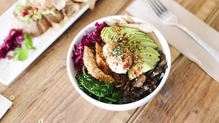 This vegetarian power bowl is finished with tempeh, avocado, and a poached egg. - PHOTO BY MELATI CITRAWIREJA