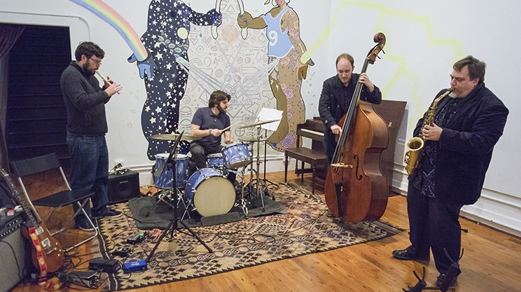 Guitarist Ben Westfall (on recorder), drummer Aaron Levin, bassist Leo Lober-Tracy, and saxophonist Rent Romus improvised a quick set before an Oakland Freedom Jazz Society show at Studio Grand on Jan. 22. - PHOTO BY RICHARD LOMIBAO