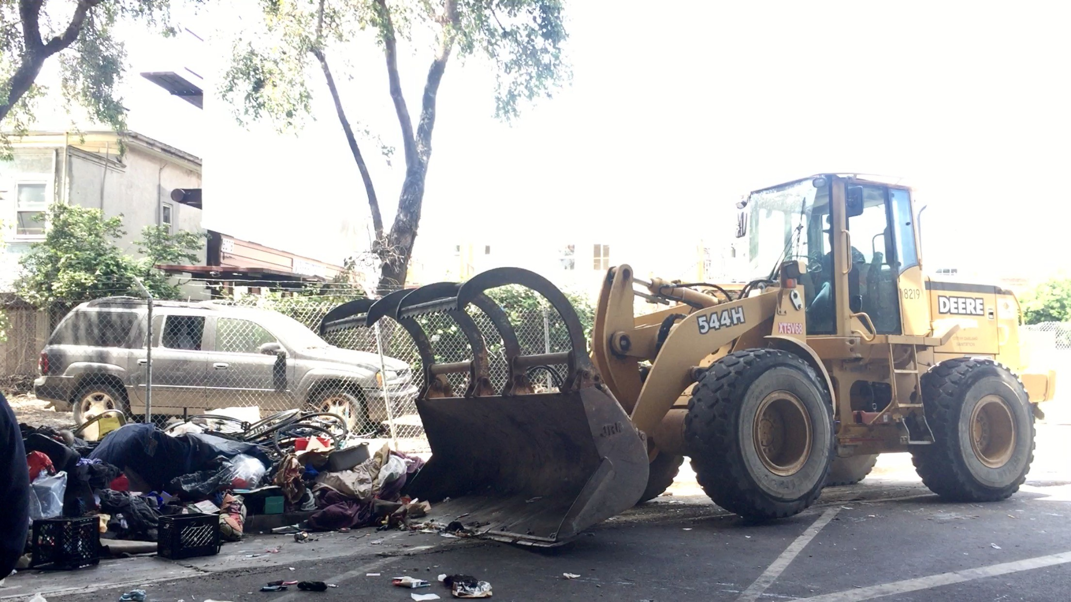 Man On Bulldozer : City of oakland 'bulldozer hit a homeless man while he