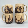 The cacti mug is made by hand.