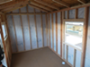 Inside an unfinished Tuff Shed at the Northgate camp. The city added insulation, windows, and other fixtures.