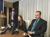 Sarah Steel and Michael Bachmann at a press conference accouncing their suit against the air district. Steele later settled.