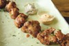 The cauliflower wings are coated in a gluten-free, adobo-spiced batter.