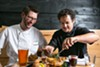 Owners Aron Ford (left) and Nick Yapor-Cox cook dishes that are perfect for family-style dining.