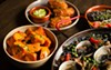 Clockwise from left: <i>patatas bravas</i>, mushroom <i>croquetas</i>, <i>morcilla</i>, and <i>arroz negro</i>.