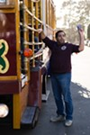 Bobak Esfandiari of San Francisco handed pamphlets to passengers of a trolly bus
