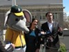 Mayor Libby Schaaf gets a hug from Stomper during a press conference with A's president David Kaval on Monday morning.