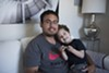 Christian Muñoz and his son in their apartment at 470 Central Avenue in Alameda.