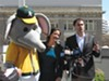 Stomper, Mayor Libby Schaaf, and A's president Dave Kaval on City Hall's roof this April. The mayor insists there will be no public subsidy for a new ballpark.