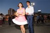A young couple gives it a spin during Friday night's Dancing Under the Stars at Jack London Square (page 62).