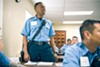 Mason addresses an officer as the class is kept late. At the academy, recruits train on the tower and in the classroom. Their day begins before dawn, and can last into early evening.