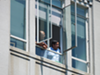 Berkeley Mayor Jesse Arreguin looks down on the demonstration from the 5th floor mayor's offices.