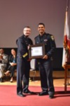 OPD Officer Giovanni LoVerde accepting an award from former Chief Sean Whent in 2015.