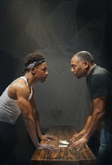 PHOTO COURTESY OF SIMONE FINNEY/UBUNTU THEATER PROJECT - Michael Curry (left) plays Booth and Dorian Lockett plays Lincoln.