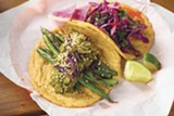 PHOTO BY LANCE YAMAMOTO - Charred green bean and pipian mole taco, nopal and cabbage taco.
