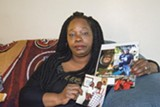 PHOTO BY SCOTT MORRIS - Barbara Doss holding photos of her son, Dujuan Armstrong, who died at Santa Rita Jail.
