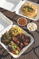 "PHOTO BY LANCE YAMAMOTO - This vegan combo plate includes brisket, shrimp, links, ""smackaroni,"" baked beans, and collard greens."