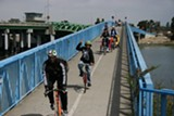 George leading the group over the bike bridge in Alameda. - Uploaded by AlamedaBicycle1522