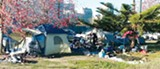 PHOTO FROM WIKICOMMONS - OUTSIDE: A homeless camp near Laney College campus in Oakland.
