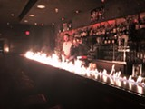 RUBY ROOM - The bar aflame at Ruby Room.