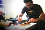 Winemaker Pietro Buttitta in the kitchen.