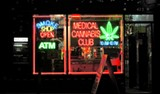 THOMAS HAWK/CREATIVE COMMONS - Neon signs in the window of a medical cannabis club on Haight Street in San Francisco.