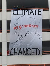 JAY YOUNGDAHL - Protestors display a sign decrying oil companies' role in climate change at this year's Iditarod.