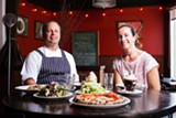 BERT JOHNSON - Owners Peter and Melissa Swanson sit down for a meal at Benchmark Pizzeria.