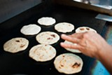 BERT JOHNSON - Each pupusa is formed by hand before griddling.