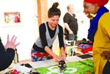 COURTESY OF HE ARTIST - Christina Victor teaching a flag making workshop.