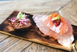 ANDRIA LO - A slice of Miyazaki beef (left) and salmon sashimi on a slab of sea salt.
