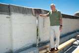 TOM MORGENSTERN - UC Berkeley professor Nick Sitar shows the gap at California Memorial Stadium due to Hayward Fault movement over the years.