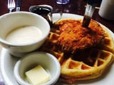 Gravy on fried chicken and waffles at Aunt Mary's.