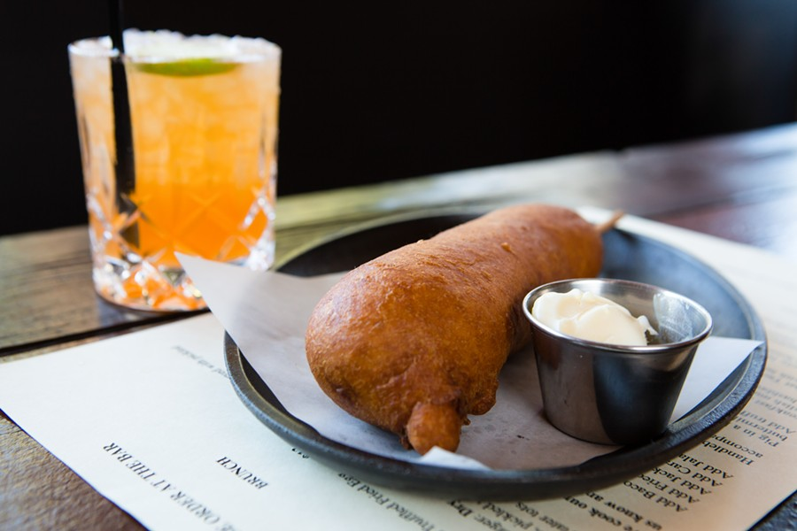 Deep-fried pig in a blanket and a cocktail. - BERT JOHNSON