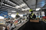 COURTESY OF WASTE MANAGEMENT - Workers at the Davis Street Recycling Center in San Leandro.