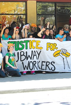 Workers rallied for a living wage outside a Subway outlet.