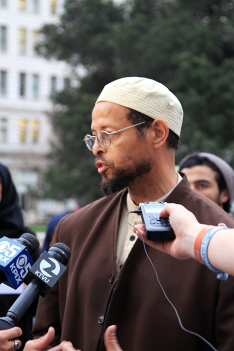 Zaid Shakir, the Imam of Lighthouse Mosque, outside City Hall before yesterday's meeting. - ALI WINSTON