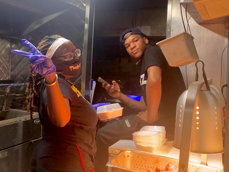 Williams and his crew prepare meals and deliver them to the homeless every night after work. - PHOTO BY DEVAUGHN DOUGLAS