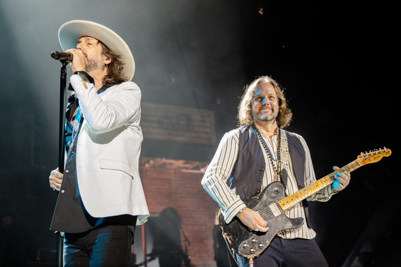 Black Crowes co-founders/brothers Chris & Rich Robinson put aside their differences to celebrate their debut record and reunite for a tour.