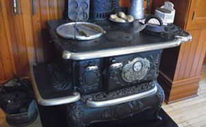 The kitchen in the Hemingway birthplace features the original stove and other Victorian fixtures. - PHOTO BY JOE CAMPER