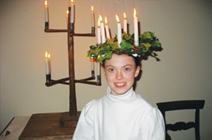 Bishop Hill celebrates its Swedish heritage with annual Saint Lucia Nights or Festival of Lights. Young girls such as Whitney Johnson wear crowns of lighted candles and serve sweets to visitors in museums and shops throughout the village. This year�� - PHOTO COURTESY OF BISHOP HILL STATE HISTORIC SITE