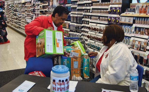 Carolyn Blackwell and Mary Hardy Hall Randolph collect diapers for the Parent Place's diaper pantry.