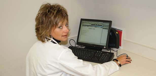 Chris Marker, RN, BSN of the Prairie Cardiovascular Consultants demonstrates the electronic medical records (EMR) system. - PHOTO BY DAVID HINE