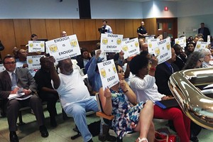 Residents were angry and surprised by a proposal that would put a homeless shelter in their neighborhood. - PHOTO BY BRUCE RUSHTON