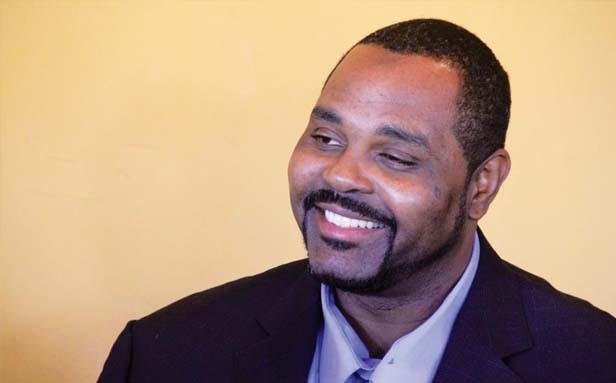 Anthony Murray smiles in a photo taken the day of his release after 14 years in prison. - PHOTO COURTESY OF ILLINOIS INNOCENCE PROJECT.