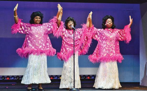 Calia Cole (Lorell), Fania Bourn (Deena) and Tuesdai Perry (Effie) perform as the Dreamettes in the Muni's Dreamgirls. - PHOTO BY DONNA LOUNSBERRY