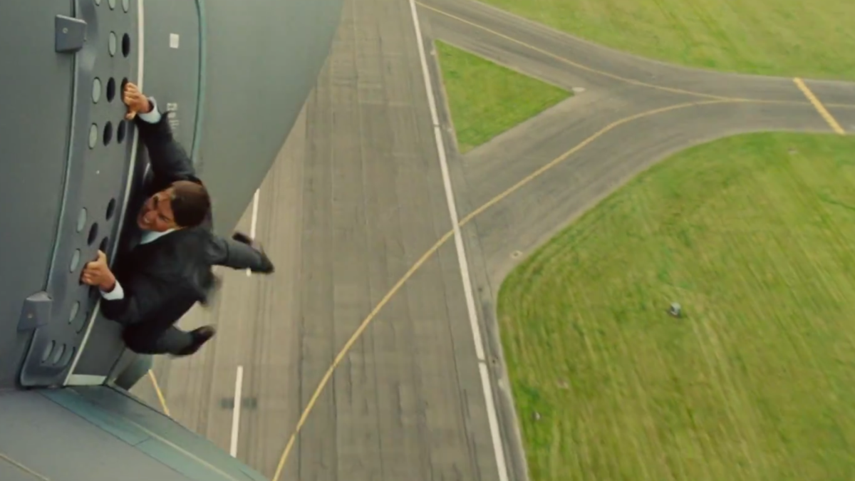 """Ethan Hunt (Tom Cruise) finds himself in a precarious position in """"Mission: Impossible - Rogue Nation"""" - COURTESY PARAMOUNT PICTURES"""