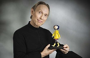 Henry Selick shows off his main character, Coraline.