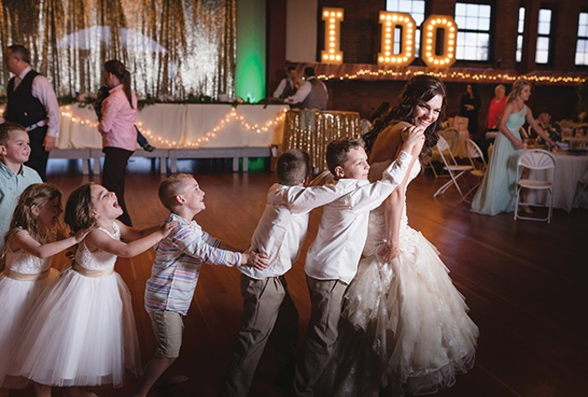 Bride Mallory Nickel leads the conga line. - PHOTO BY CHRIS WITHERS