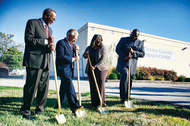 Breaking ground on the new expansion for Central Counties Health Centers is (from left to right) CCHC board chairman Bobby Hall, Springfield mayor Michael Houston, Ward 3 Ald. Doris Turner, and CCHC president and CEO Craig Glover. - PHOTO BY PATRICK YEAGLE